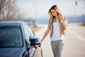 Girl with car — Stock Photo