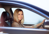 Girl in her car — Stock Photo