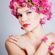 Girl with flower hairstyle - Stock Photo