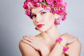 Girl with flower hairstyle — Stock Photo