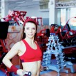 Girl with dumbbell in fitness center — Stok fotoğraf