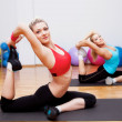Two stretching girls — Stock Photo