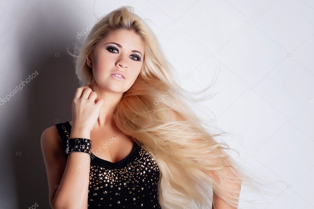 Young beautiful blonde in studio  Stock Photo #9958574
