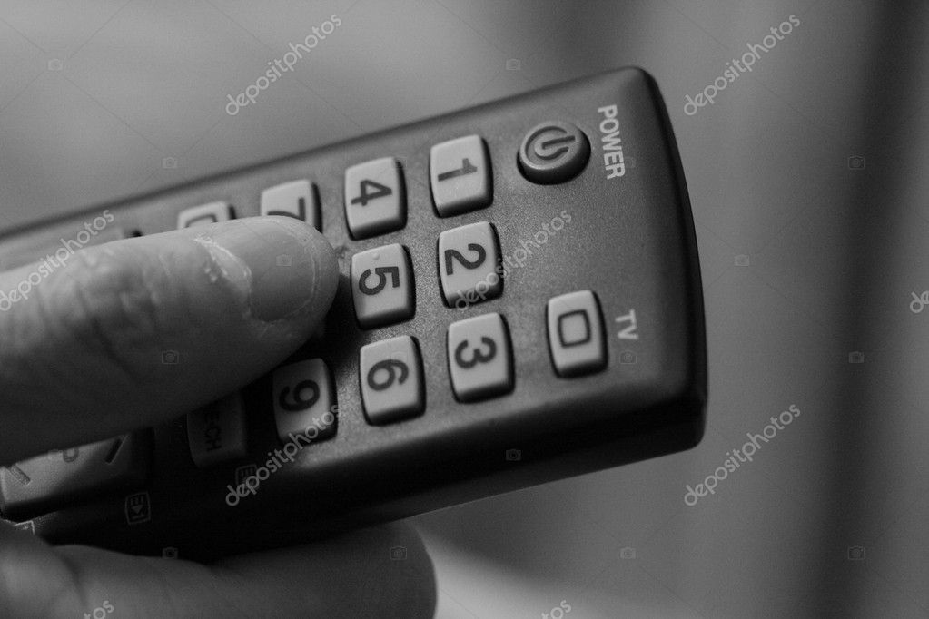 Tv Remote Control and human Finger pressing the button — Stock Photo #8575193