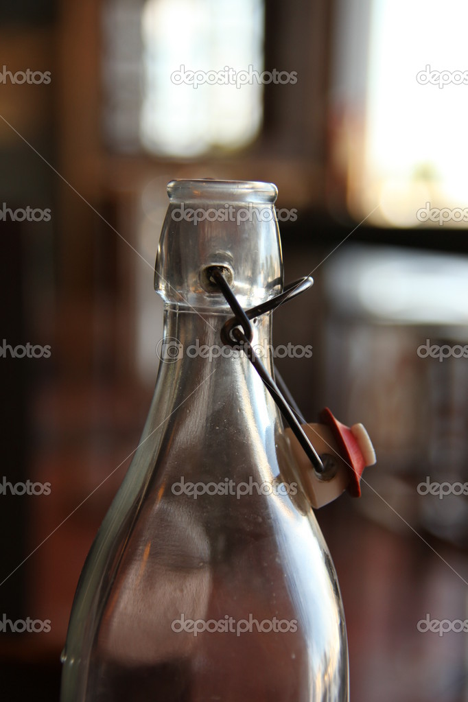 Glass Water Bottle in the restaurant with blur background — Stock Photo #8575812