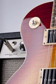 Sunburst Electric guitar along wtih Amplifier — Stock Photo