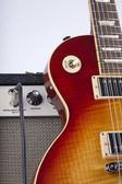 Sunburst Electric Guitar leaning on a Vintage Amplifier With Patch Cord — Stock Photo
