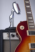 Sunburst Electric Guitar with Amplifier and Vintage Microphone — Stock Photo