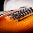 Close up of Back Bridge of a Sunburst Electric Guitar — Stock Photo