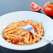 Italian pasta - trofie with tomato sauce - Stock Photo