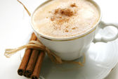 Coffee with cinnamon stick — Stock Photo