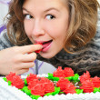 Stock Photo: Happy girl eat cake