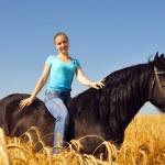 Beautiful gitl in the field on horseback — Stock Photo #8883982