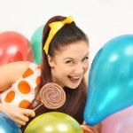 Cute girl among ballons — Stock Photo #8884060