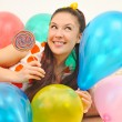 Girl to smile a happy smile with balloons and bonbon — Stock Photo #8884076