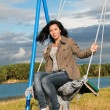 Beautiful girl on swing — Stock Photo #8884095