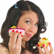 Pretty young woman with two tasty cakes — Stock Photo