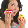 Cute young woman with two tasty cakes — Stock Photo