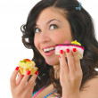 Nice young woman with two tasty cakes — Stock Photo