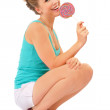 Pretty happy woman with lollipop — Stock Photo