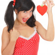 Beauty girl with red heart-shaped pepper — Stock Photo