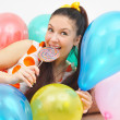Cute girl among ballons — Stock Photo