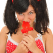 Pretty girl with red flower looking at camera — Stock Photo