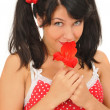 Pretty girl with red flower — Stock Photo