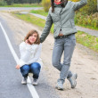 Pretty girls on road — Stock Photo