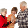 Happy grandparents and granddaughter — Stock Photo #8884812