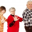 Stock Photo: Happy grandparents and granddaughter play the fool