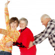 Stock Photo: Happy grandparents and granddaughter play fool