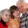 Happy grandparents and granddaughter looking at camera — Stock Photo