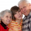 Happy grandparents and granddaughter looking at camera — Stock Photo #8884827