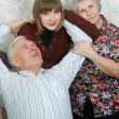 Happy grandparents and granddaughter — Stock Photo