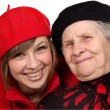 Happy grandmother and granddaughter with berets — Stock Photo #8884978