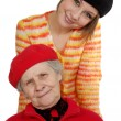 Grandmother and granddaughter with berets — Stock Photo #8884998