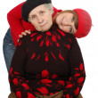 Happy grandmother and granddaughter with berets — Stock Photo #8885000