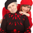 Stock Photo: Happy grandmother and granddaughter with berets