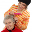 Grandchild brushes a grandmother — Stock Photo #8885010