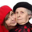Happy grandmother and granddaughter with berets — Stock Photo #8885012