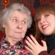 Grandmother and granddaughter gossiping — Stock Photo
