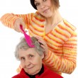 Grandchild brushes a grandmother — Stock Photo