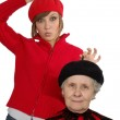Happy grandmother and granddaughter with berets — Stock Photo #8885016