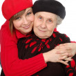 Happy grandmother and granddaughter with berets — Stock Photo #8885019