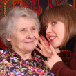 Grandmother and granddaughter gossiping — Stock Photo #8885028