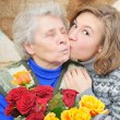 Girl kissed grandmother - Stock Photo