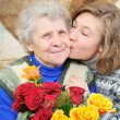 Granddaughter kissed grandmother — Stock Photo #8885036