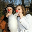 Stock Photo: Granddaughter and granny with clown noses rest in autumn park