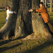 Daughter and granny embrace giant tree — Stock Photo